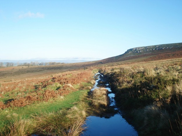 A wet Roman Road, Heughscar and distant Pennines.