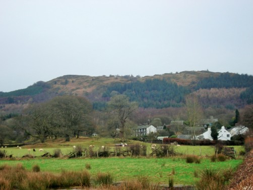 The village of Staveley with the fell rising above.