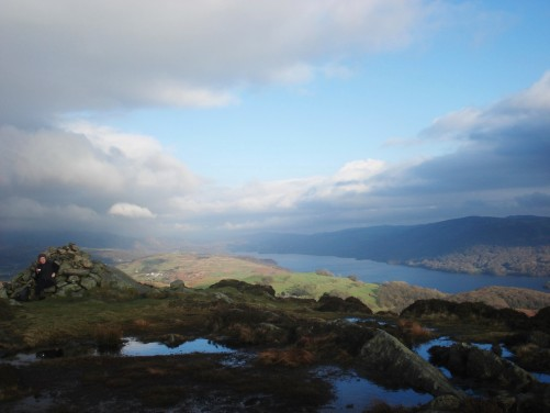 Summit of Beacon Fell with Coniston Water below.